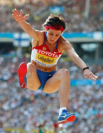 FILE PHOTO: Tatyana Lebedeva of Russia competes in the women's long jump final during the world athletics championships in Berlin August 23, 2009. REUTERS/Dominic Ebenbichler