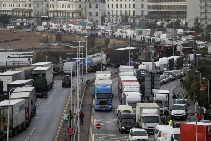 Trucks parked on the roadside whilst the Port remains closed, in Dover, southern England, Tuesday, Dec. 22, 2020. Trucks waiting to get out of Britain backed up for miles and people were left stranded at airports as dozens of countries around the world slapped tough travel restrictions on the U.K. because of a new and seemingly more contagious strain of the coronavirus in England. (AP Photo/Kirsty Wigglesworth)