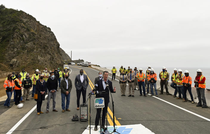 FILE - In this Friday, April 23, 2021, file photo, California Gov. Gavin Newsom speaks during a news conference at the newly reopened California's Highway 1 (SR-1) at Rat Creek near Big Sur, Calif. Heavy rainstorms in Jan. 2021, caused a landslide, which closed the scenic highway. A fading coronavirus crisis and an astounding windfall of tax dollars have reshuffled California's emerging recall election, allowing Democratic Gov. Newsom to talk of a mask-free future and propose billions in new spending for schools and businesses as he looks to fend off Republicans who depict him as a foppish failure. (AP Photo/Nic Coury, File)