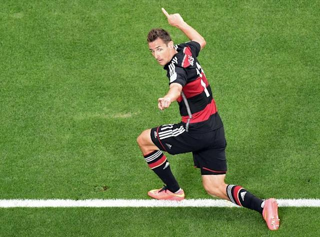Germany's Miroslav Klose celebrates scoring his side's 2nd goal during the World Cup semifinal soccer match between Brazil and Germany at the Mineirao Stadium in Belo Horizonte, Brazil, Tuesday, July 8, 2014. (AP Photo/Francois Xavier Marit, Pool)