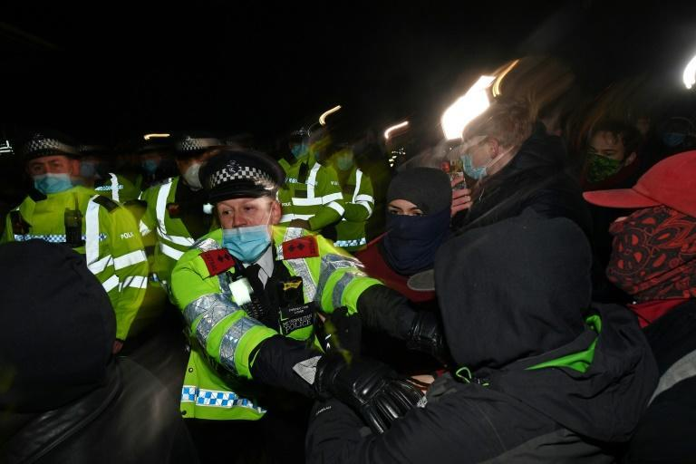 Police officers scuffled with some members of the hundreds-strong crowd that gathered in the evening despite coronavirus restrictions for a candlelit tribute