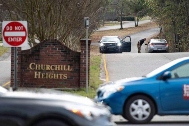 PHOTO: A law enforcement officer talks with a driver at a road block near an entrance to the Churchill Heights neighborhood, Feb.13, 2020, in Cayce, S.C. (Sean Rayford/AP)