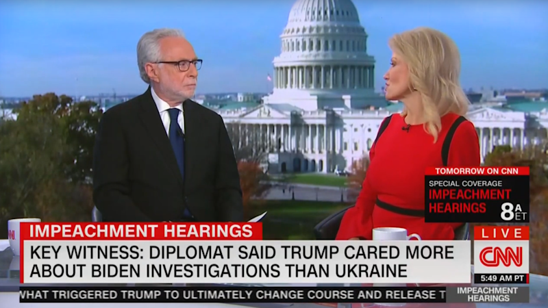 CNN's Wolf Blitzer listens to Kellyanne Conway during a live interview Thursday. (Screengrab via Yahoo News)