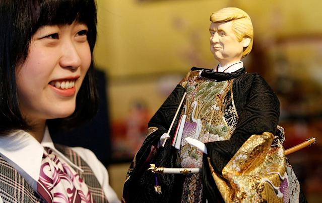 <p>An employee of Japanese doll-maker Kyugetsu Inc poses with a doll depicting U.S. President Donald Trump, as part of a traditional set of Japanese ornamental hina dolls used in Japan to celebrate Girls' Day, at the company's main shop in Tokyo, Japan, Jan. 26, 2017. (Photo: Toru Hanai/Reuters) </p>