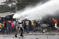 <p>A supporter of Kenyan opposition leader Raila Odinga is sprayed with water by police in Nairobi, Kenya, Nov. 17, 2017. (Photo: Baz Ratner/Reuters) </p>