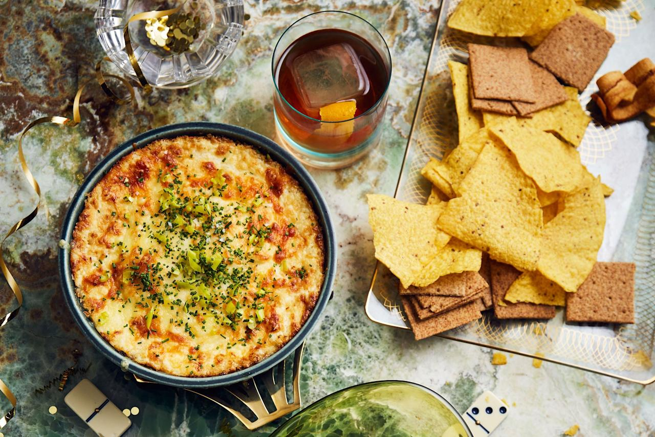 """When great dips get together, it's magic—and not the scary kind. This recipe boasts all the beauty of a creamy onion dip with the irresistible appeal of queso. <a href=""""https://www.epicurious.com/recipes/food/views/baked-three-cheese-onion-dip-with-chive-and-peperoncini?mbid=synd_yahoo_rss"""">See recipe.</a>"""