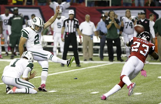 New York Jets kicker Nick Folk (2) kicks the winning field goal against Atlanta Falcons cornerback Robert Alford (23) during the second half of an NFL football game, Monday, Oct. 7, 2013, in Atlanta. The Jets won 30-28. (AP Photo/John Bazemore)
