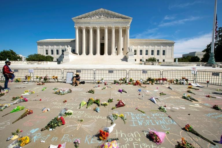 Messages and flowers are left outside of the US Supreme Court in memory of Justice Ruth Bader Ginsburg