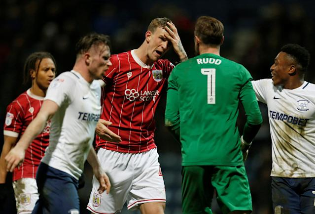 "Soccer Football - Championship - Preston North End vs Bristol City - Deepdale, Preston, Britain - March 6, 2018 Bristol City's Aden Flint clashes with Preston North End's Declan Rudd before being sent off Action Images/Ed Sykes EDITORIAL USE ONLY. No use with unauthorized audio, video, data, fixture lists, club/league logos or ""live"" services. Online in-match use limited to 75 images, no video emulation. No use in betting, games or single club/league/player publications. Please contact your account representative for further details."