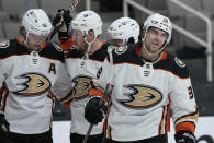 Anaheim Ducks center Derek Grant, right, smiles after scoring a goal against the San Jose Sharks during the second period of an NHL hockey game Wednesday, April 14, 2021, in San Jose, Calif. (AP Photo/Tony Avelar)