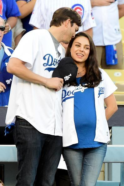 Ashton and Mila (Photo by Harry How/Getty Images)
