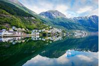 """<p>The Norwegian fjords conjure images of steep mountains and deep blue waters reflecting Europe's breathtaking natural beauty at its best. For travellers embarking on a <a href=""""https://www.primaholidays.co.uk/tours/amsterdam-norway-fjords-cruise-hairy-bikers"""" rel=""""nofollow noopener"""" target=""""_blank"""" data-ylk=""""slk:Norway fjords cruise"""" class=""""link rapid-noclick-resp"""">Norway fjords cruise</a>, some of the most stunning fjords in the country are waiting to be explored by ship, from Geirangerfjord to Hardangerfjord.</p><p>Fjords appear like still lakes but are prolonged arms of the sea containing saltwater. Protected by UNESCO and a symbol of Norway, the Norwegian fjords are as dreamy as they appear in photos. If you're looking for a relaxing, slow-paced escape surrounded by nature and tradition, they'll make you feel like you're in a secluded paradise.</p><p><a class=""""link rapid-noclick-resp"""" href=""""https://www.primaholidays.co.uk/tours/amsterdam-norway-fjords-cruise-hairy-bikers"""" rel=""""nofollow noopener"""" target=""""_blank"""" data-ylk=""""slk:SEE THE FJORDS WITH TV'S HAIRY BIKERS"""">SEE THE FJORDS WITH TV'S HAIRY BIKERS</a></p><p>Often located deep inland with cliffs towering above them on each side, they're often intertwined, allowing you to sail from one to another before returning to the sea.</p><p>They take you back to Norway's past and show you the country's natural beauty, while flanked by pretty villages, waterfalls and plenty of peaceful spots to breathe in the tranquility. If you like to get active, there are many opportunities for hiking, cycling and kayaking to get even closer to the unforgettable fjords during a cruise.</p><p>Ready to see them for yourself? Join Prima's <a href=""""https://www.primaholidays.co.uk/tours/amsterdam-norway-fjords-cruise-hairy-bikers"""" rel=""""nofollow noopener"""" target=""""_blank"""" data-ylk=""""slk:exclusive Norway fjords cruise"""" class=""""link rapid-noclick-resp"""">exclusive Norway fjords cruise</a> in June 2022, with TV cooks the Hairy Bikers joining us on"""