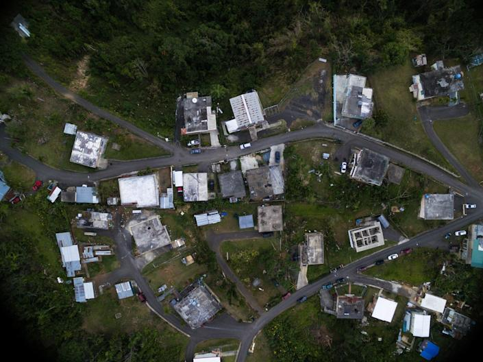 An overhead view of one of the communities Iniciativas De Paz serves reveals that some houses are entirely without roofs, and others are still making do with the tarp roofs installed by FEMA. (Photo: Alexis Fairbanks)