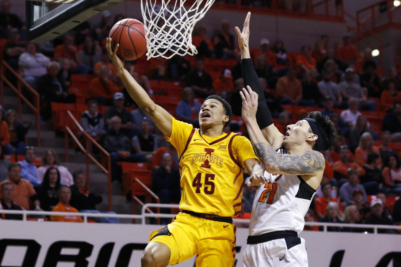 Iowa State guard Rasir Bolton (45) shoots in front of Oklahoma State guard Lindy Waters III (21) in the second half of an NCAA college basketball game in Stillwater, Okla., Saturday, Feb. 29, 2020. (AP Photo/Sue Ogrocki)