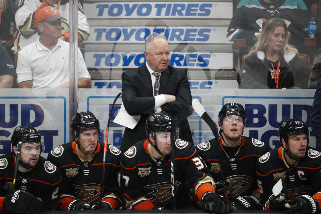 FILE - In a Wednesday, Jan. 23, 2019 file photo, Anaheim Ducks coach Randy Carlyle, center, watches during the third period of the team's NHL hockey game against the St. Louis Blues, in Anaheim, Calif. The Anaheim Ducks have fired coach Randy Carlyle amid a seven-game losing streak. The Ducks announced Sunday, Feb. 10, 2019 that general manager Bob Murray would take over as interim coach for the remainder of the regular season. (AP Photo/Jae C. Hong, File)