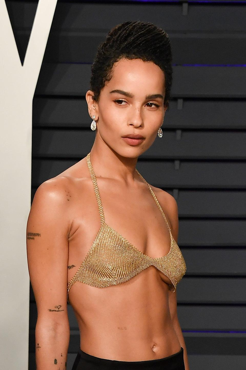<p>Though it's hidden in many photos, a small script tattoo can be seen on Kravitz's ribs. She has not revealed its meaning.</p>
