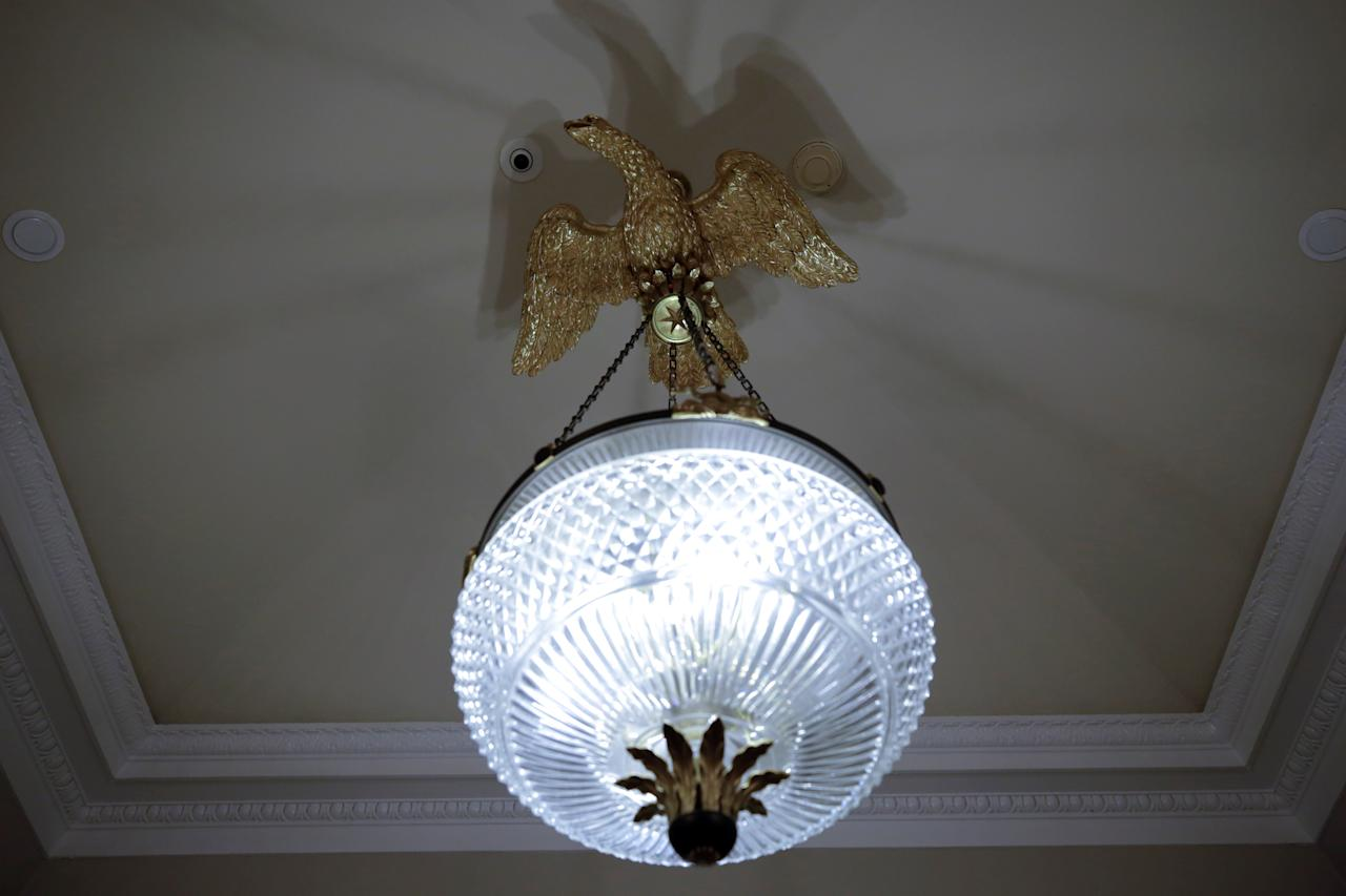 <p>A chandelier is seen outside the Oval Office of the White House after a renovation in Washington, Aug. 22, 2017. (Photo: Yuri Gripas/Reuters) </p>