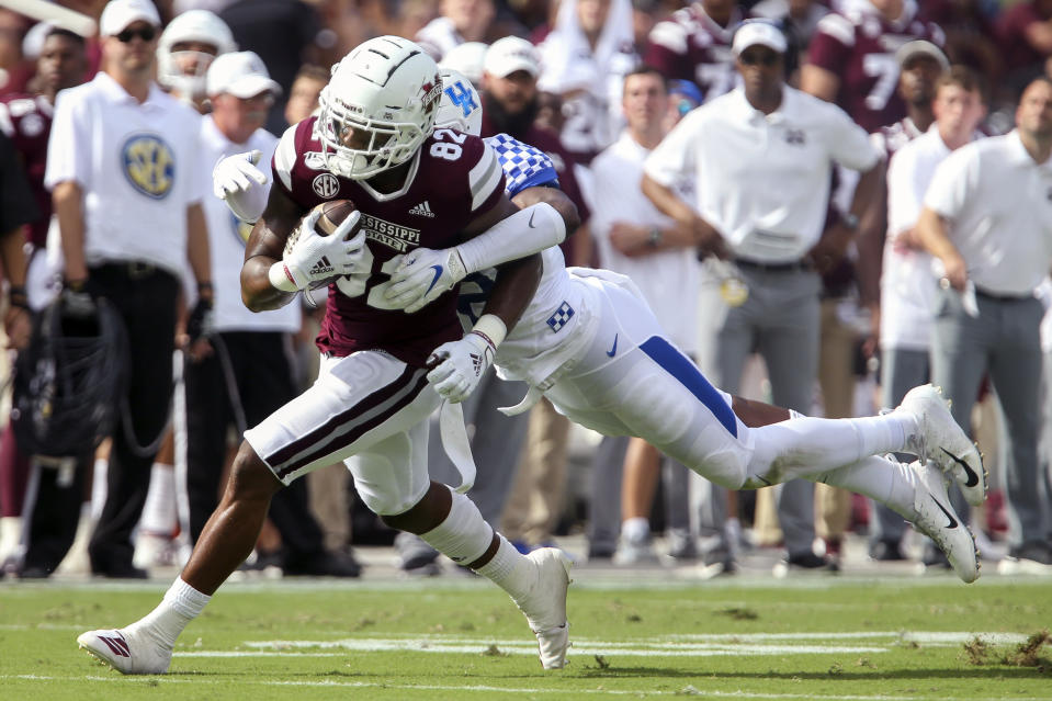 Mississippi State tight end Farrod Green (82) gets wrapped up by a Kentucky defender during the first half of an NCAA college football game, Saturday, Sept. 21, 2019, in Starkville, Miss. (AP Photo/Kelly Donoho)
