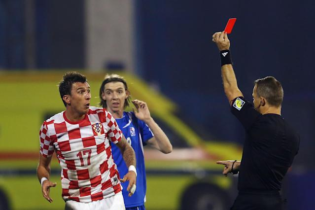 Soccer's red and yellow card system is one of many quirky and subjective parts of the laws of the game. (Getty)