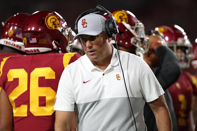 Clay Helton of the USC Trojans looks on from the sidelines during a game. (Getty)