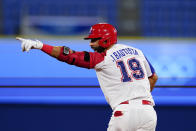 Dominican Republic's Jose Bautista reacts after hitting the game winning RBI single during the ninth inning of a baseball game against Israel at the 2020 Summer Olympics, Tuesday, Aug. 3, 2021, in Yokohama, Japan. The Dominican Republic won 7-6. (AP Photo/Matt Slocum)