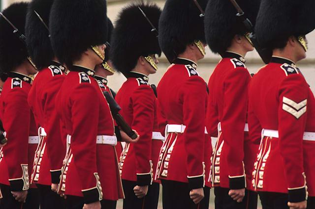 Shocking moment Queen's Guard pulls gun on tourist