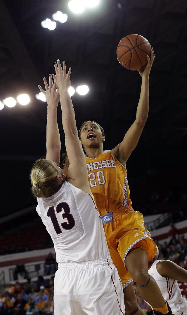 Tennessee center Isabelle Harrison (20) goes up for a shot against Georgia forward Merritt Hempe (13) in the first half of an NCAA women's college basketball game, Sunday, Jan. 5, 2014, in Athens, Ga. (AP Photo/John Bazemore)