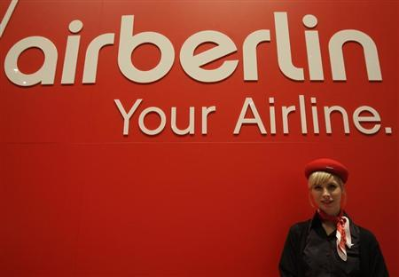 A woman stands behind the exhibition stand of Air Berlin at the ITB tourism fair in Berlin