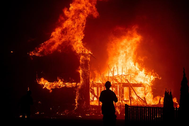 "A home burns as the 2018 Camp Fire rages through Paradise, Calif., in a scene from the Ron Howard documentary ""Rebuilding Paradise."""