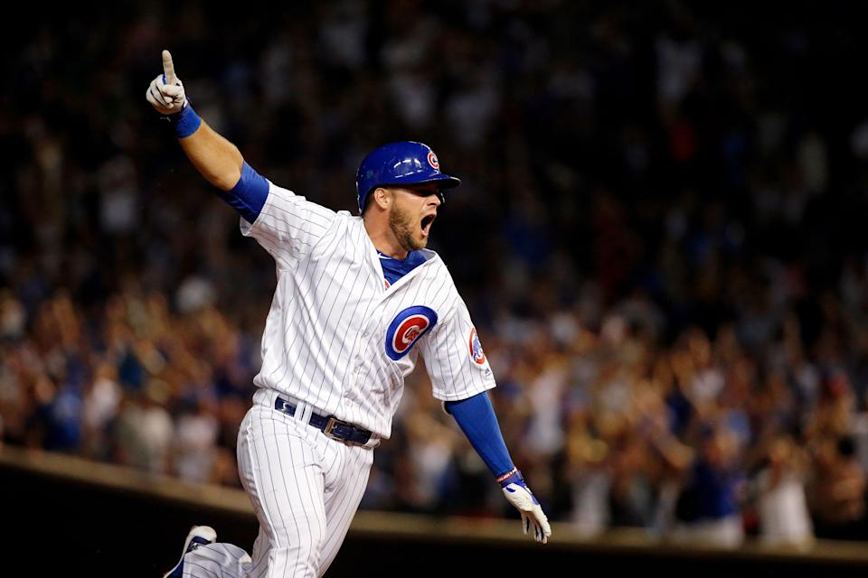 CHICAGO, IL - AUGUST 12:  David Bote #13 of the Chicago Cubs celebrates as he rounds the bases after hitting a walk-off grand slam against the Washington Nationals at Wrigley Field on August 12, 2018 in Chicago, Illinois. The Chicago Cubs won 4-3.  (Photo by Jon Durr/Getty Images)