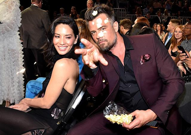 <p>Popcorn, anyone? Josh Duhamel cracked up fellow Billboard Music Awards presenter Olivia Munn when he flicked a few kernels at the camera. (Photo: Kevin Mazur/BBMA2017/Getty Images for dcp) </p>