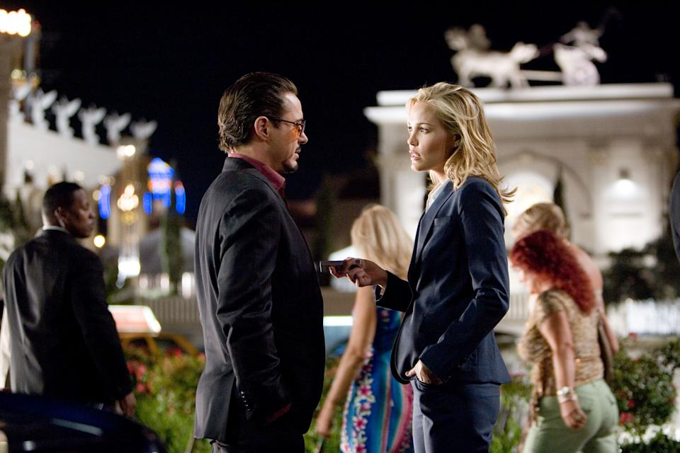 Leslie Bibb's Christine Everheart grills Robert Downey Jr.'s Tony Stark in <i>Iron Man</i> (2008)
