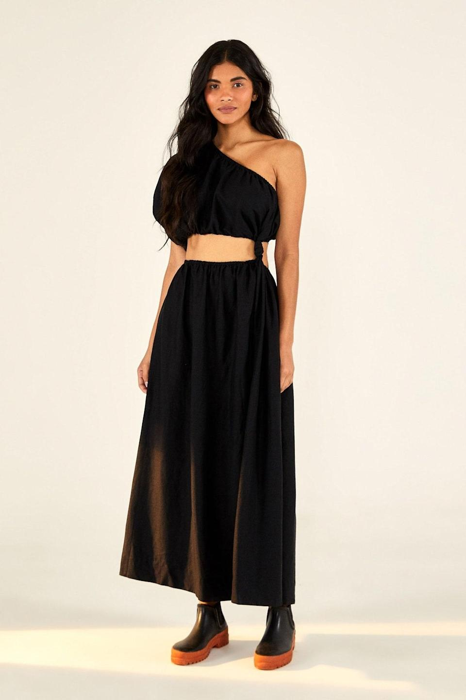"""The only thing we love more than a cold-shoulder moment is when it's served with a healthy side of midriff. $200, Farm Rio. <a href=""""https://www.farmrio.com/collections/new-in/products/one-shoulder-black-dress"""" rel=""""nofollow noopener"""" target=""""_blank"""" data-ylk=""""slk:Get it now!"""" class=""""link rapid-noclick-resp"""">Get it now!</a>"""
