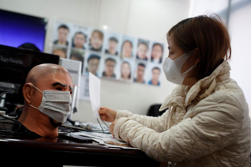A software engineer tests a facial recognition program that identifies people when they wear a face mask at the development lab of the Chinese electronics manufacturer Hanwang (Hanvon) Technology in Beijing as the country is hit by an outbreak of the novel coronavirus (COVID-19), China, March 6, 2020. Picture taken March 6, 2020. REUTERS/Thomas Peter