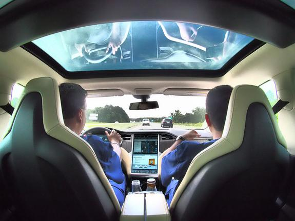Dr. Jamin Brahmbhatt and Dr. Sijo Parekattil in their Tesla from the 2014 Drive for Men's Health.