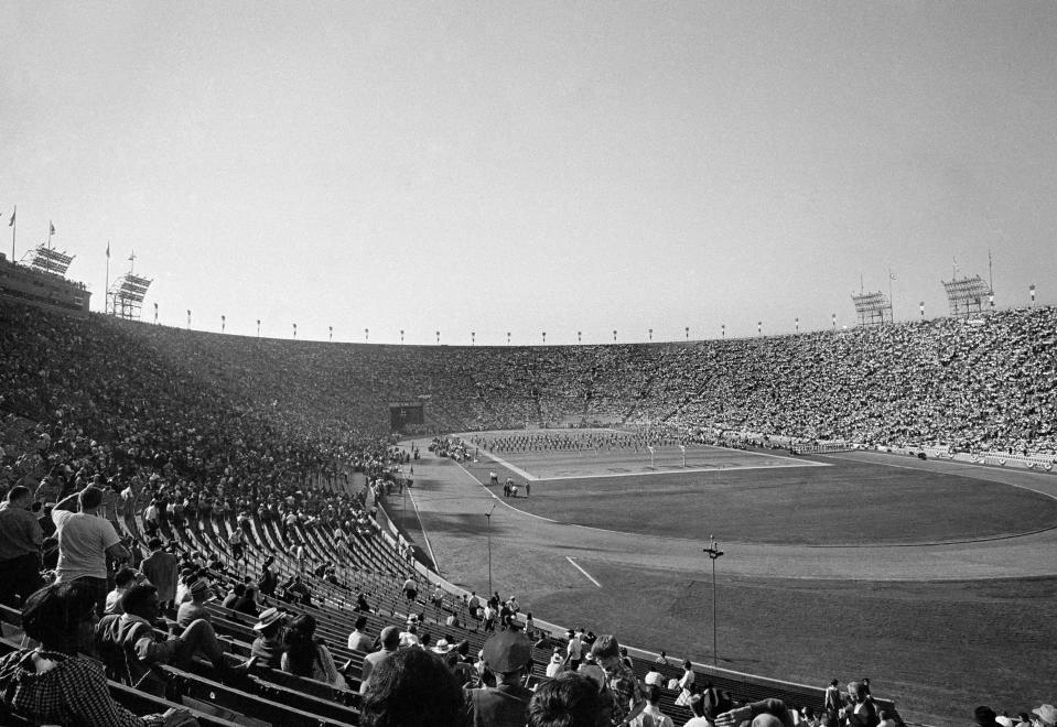 FILE - In this Jan. 15, 1967, file photo, thousands of fans attend the first AFL-NFL World Championship Game now known as Super Bowl I between the Green Bay Packers and the Kansas City Chiefs in Los Angeles. Green Bays proven old pros carried the National Football League to a 35-10 victory over the Chiefs of the American Football League in the first Super Bowl under the brilliant direction of Bart Starr. (AP Photo/File)