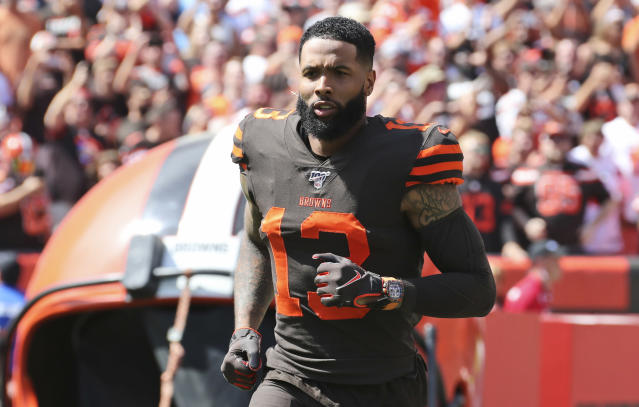 """FILE - In this Sunday, Sept. 8, 2019, file photo, Cleveland Browns wide receiver Odell Beckham Jr. is introduced as he runs out on the field before an NFL football game against the Tennessee Titans, in Cleveland. Odell Beckham Jr. says former Browns defensive coordinator Gregg Williams instructed his players to """"take me out"""" of a preseason game in 2017. The Pro Bowl wide receiver sustained an ankle injury when Cleveland's Briean Boddy-Calhoun cut his legs out while he was with the New York Giants. Beckham said current Cleveland players told him that Williams instructed them to """"take me out of the game, and it's preseason."""" (AP Photo/Ron Schwane, File)"""