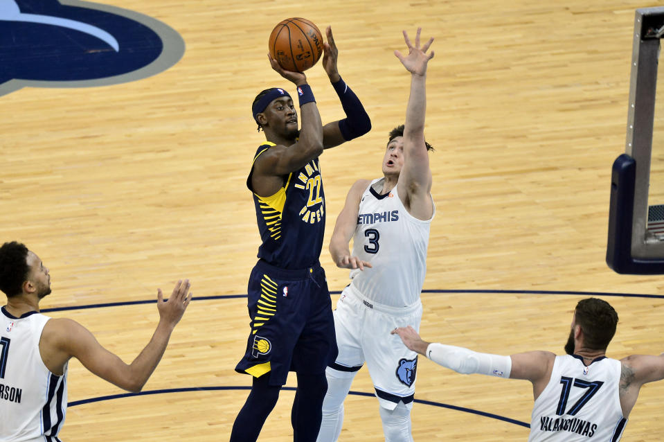 Indiana Pacers guard Caris LeVert (22) shoots against Memphis Grizzlies guard Grayson Allen (3) in the second half of an NBA basketball game Sunday, April 11, 2021, in Memphis, Tenn. (AP Photo/Brandon Dill)