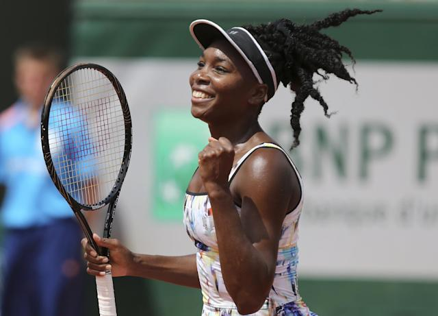 Venus Williams of the U.S, reacts after defeating Switzerland's Belinda Bencic in the first round match of the French Open tennis tournament at the Roland Garros stadium, in Paris, France, Sunday, May 25, 2014. Williams won 6-4, 6-1. (AP Photo/David Vincent)