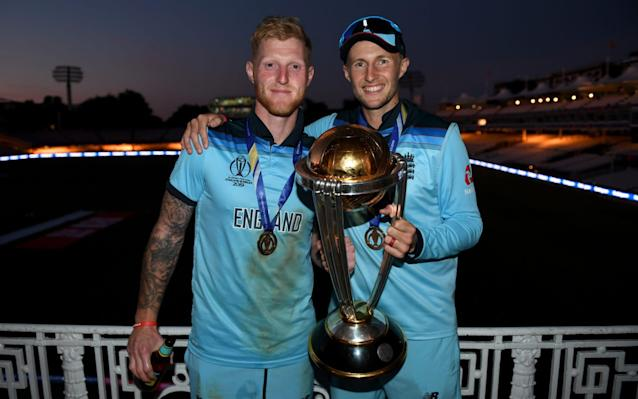 Ben Stokes and Joe Root on the balcony at Lord's with the Cricket World Cup trophy - ICC