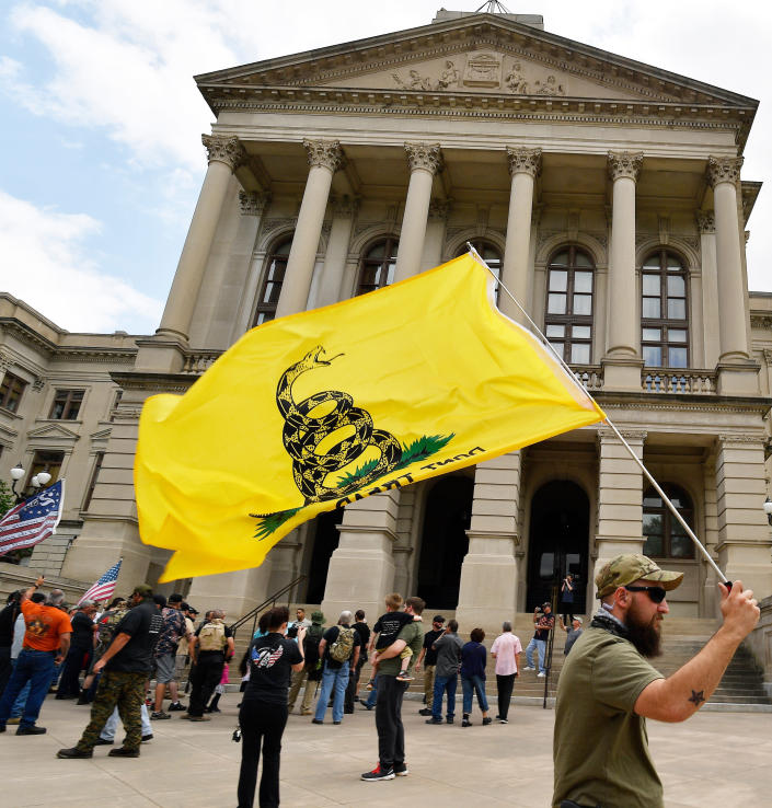 <p>People participate in a gun-rights rally at the state capitol, Saturday, April 14, 2018, in Atlanta, Ga. (Photo: Mike Stewart/AP) </p>