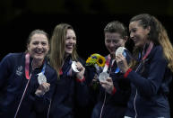 Silver medalists, France Sabre team, celebrate on the podium during the medal ceremony for the women's Sabre team final medal competition at the 2020 Summer Olympics, Saturday, July 31, 2021, in Chiba, Japan. (AP Photo/Hassan Ammar)