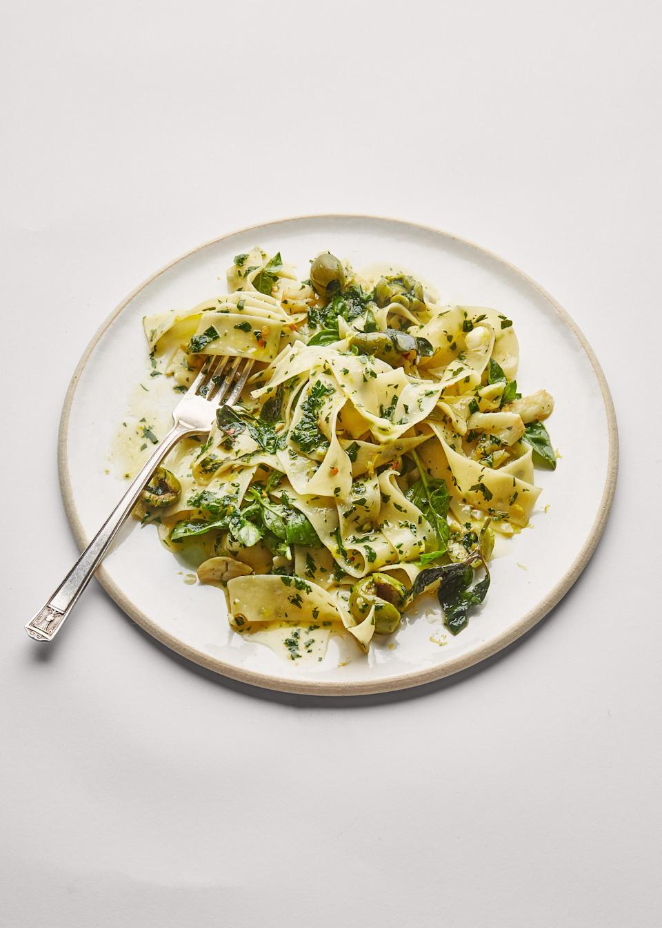 """<a href=""""https://www.bonappetit.com/recipe/herby-pasta-with-garlic-and-green-olives?mbid=synd_yahoo_rss"""" rel=""""nofollow noopener"""" target=""""_blank"""" data-ylk=""""slk:See recipe."""" class=""""link rapid-noclick-resp"""">See recipe.</a>"""