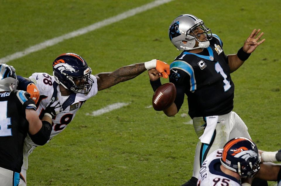 FILE - In this Feb. 7, 2016, file photo, Denver Broncos' Von Miller (58) strips the ball from Carolina Panthers' Cam Newton (1) during the second half of the NFL Super Bowl 50 football game in Santa Clara, Calif. (AP Photo/Charlie Riedel, File)