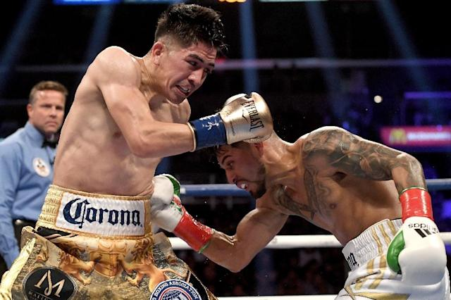 WBA featherweight champion Leo Santa Cruz, at left against Abner Mares, puts his title at risk Saturday against fellow Mexican Rafael Rivera (AFP Photo/Jayne Kamin-Oncea)