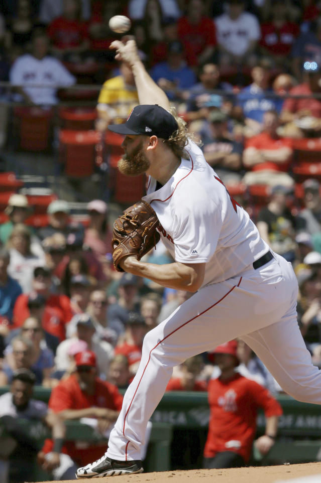Boston Red Sox's Andrew Cashner delivers a pitch against the Los Angeles Angels in the first inning of a baseball game, at Fenway Park, Sunday, Aug. 11, 2019, in Boston. (AP Photo/Steven Senne)