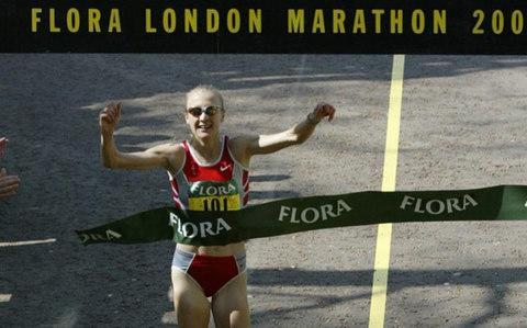 <span>Paula Radcliffe crosses the line at the 2003 London Marathon</span> <span>Credit: Russell Cheyne </span>