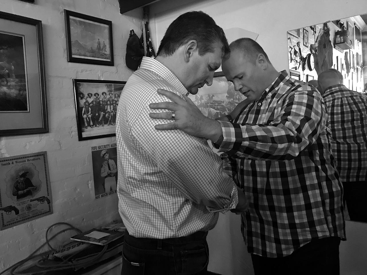 <p>A man prays for Sen. Ted Cruz after a campaign event in Sulphur Springs, Texas. (Photo: Holly Bailey/Yahoo News) </p>
