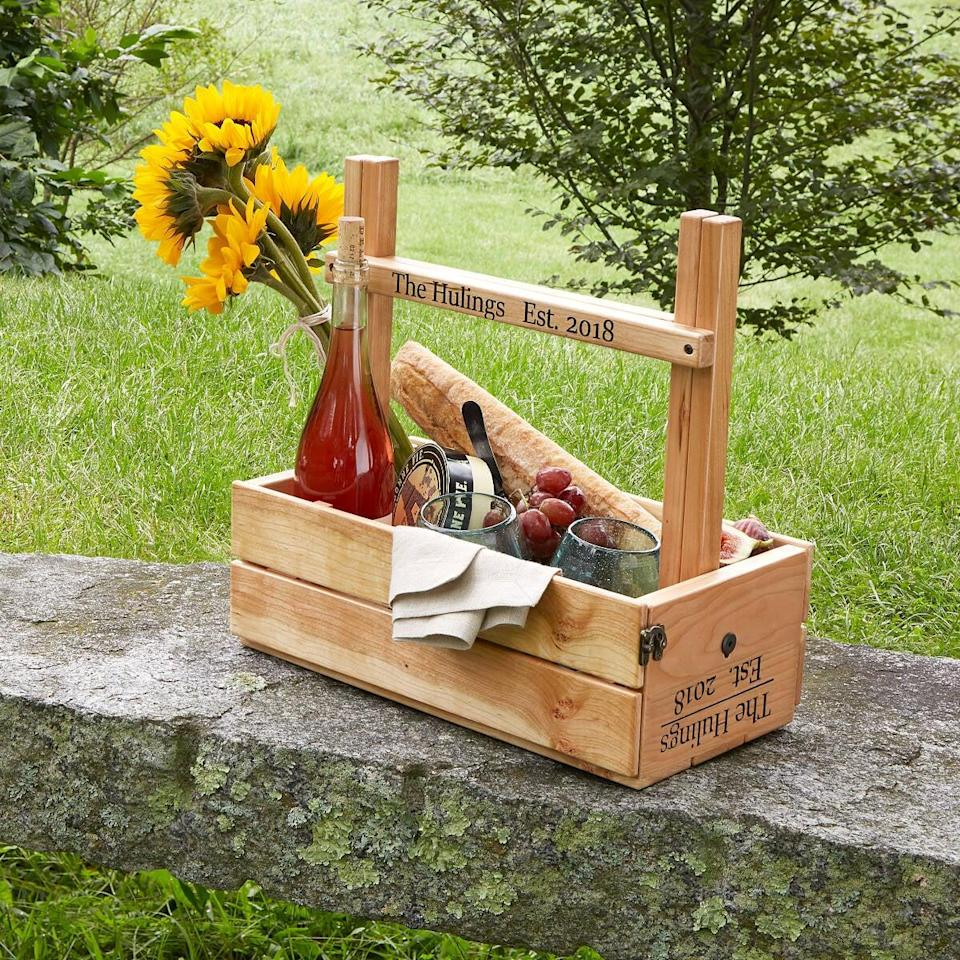 <p>Just in time for spring, this <span>Personalized Picnic Table Wine Carrier</span> ($180) will help them create new memories.</p>