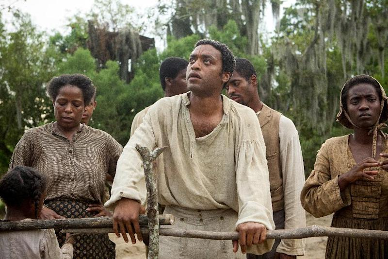 """This image released by Fox Searchlight shows Chiwetel Ejiofor, center, in a scene from the film, """"12 Years A Slave."""" Corruption tale """"American Hustle,"""" digital love story """"Her"""" and historic saga """"12 Years a Slave"""" are among the motion picture nominees for the Producers Guild of America announced Thursday, Jan. 2, 2014. (AP Photo/Fox Searchlight, Jaap Buitendijk)"""